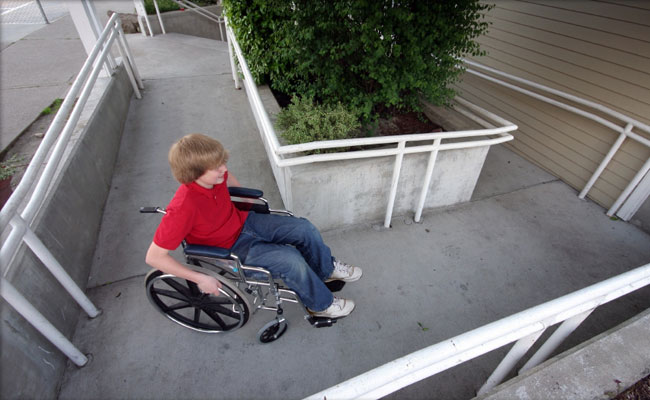 Child on wheelchair using ramp